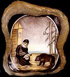 Преподобный Серафим Саровский кормящий медведя